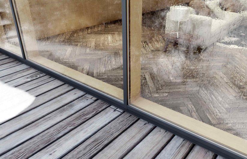 Vue extérieure d'un mur-rideau avec revêtement en aluminium bronze antique
