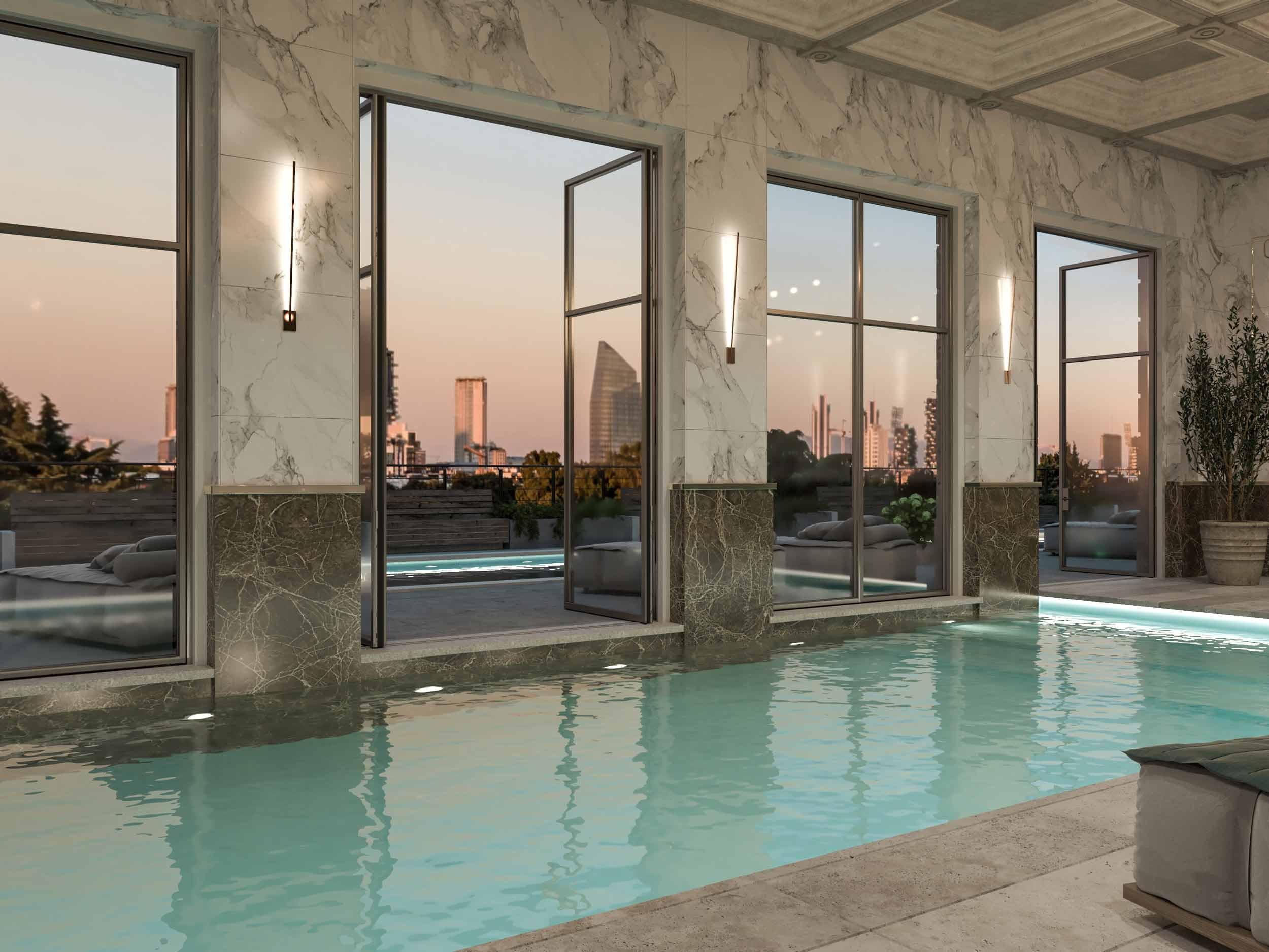 Vue d'une piscine intérieure avec fenêtres à double battant Skyline Metal