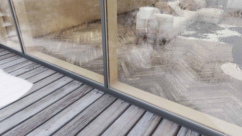 Détail du profilé en bois d'un mur-rideau recouvert d'aluminium effet bronze