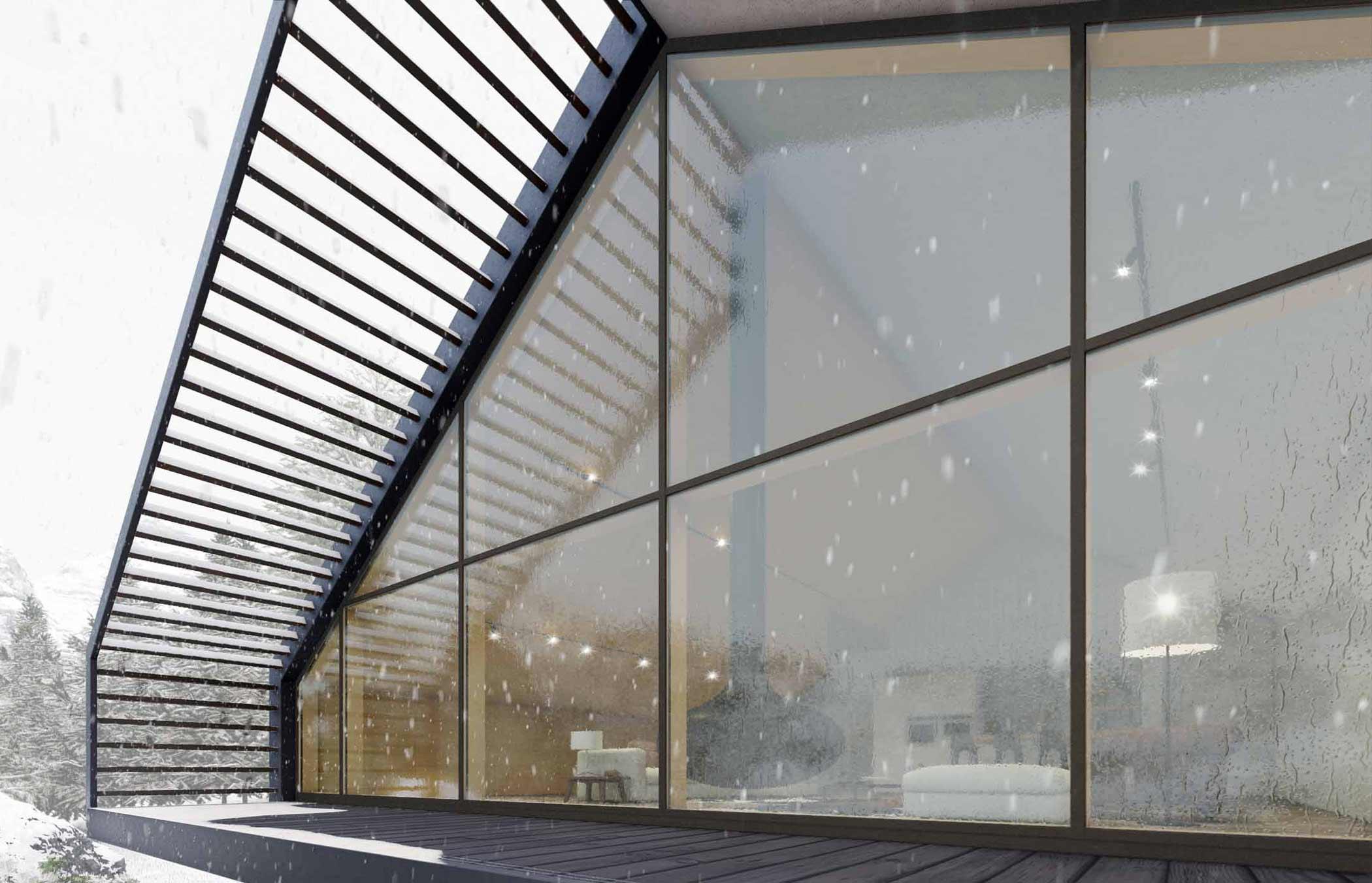 Vue d'ensemble d'une façade vitrée avec des profilés fins recouverts d'aluminium
