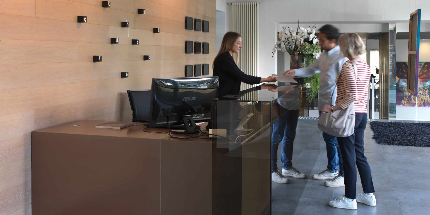 View of the reception on the ground floor with two customers