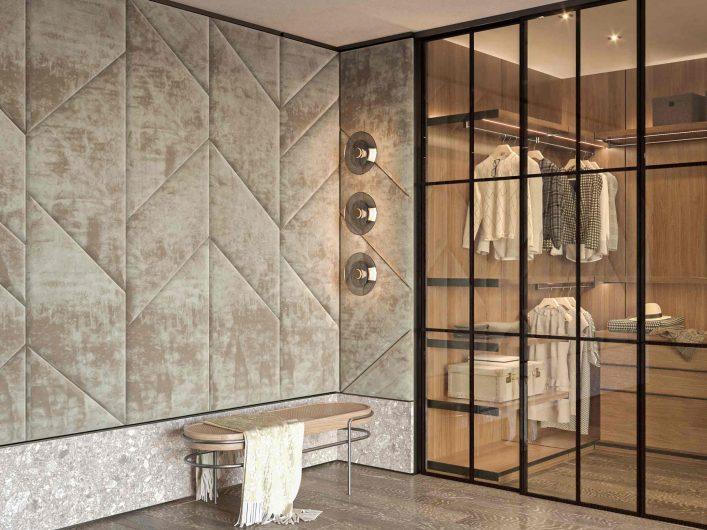 Vue d'un dressing avec un mur recouvert de boiserie de velours à panneaux géométriques