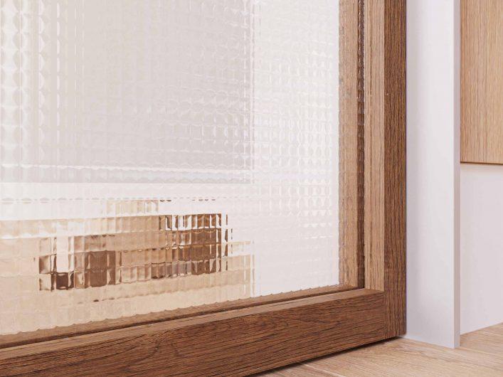 Détail de la finition en verre carré transparent
